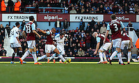 Pictured: Pablo Hernandez of Swansea (C in white) is challenged by two West Ham players. 01 February 2014<br />