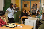 Education High School female visitor presenting about her career path to group of high school students in classroom