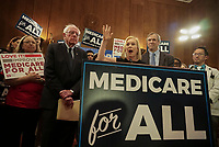 "United States Senator Kirsten Gillibrand (Democrat of New York), center, joins US Senator Bernie Sanders (Independent of Vermont), left, and US Senator Ed Markey (Democrat of Massachusetts), right, as Sanders announces he has introduced a new version of his ""Medicare for All"" plan at a press conference on Capitol Hill in Washington DC on April 10, 2019.  The Sanders plan will replace job-based and private health insurance with a government plan that guarantees coverage, including long-term care, for all citizens. Photo Credit: Stefani Reynolds/CNP/AdMedia"