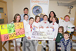 BIDDIES: Members of the Kilgobnet National School Biddy Group presenting a cheque for €522 from the recent collection to Enable Ireland in Tralee on Wednesday, front l-r: Chloe Doona, Johnathan Kissane, Padraig Cronin, Laura Hayes, Tara Breen, Chloe West, Tara Breen, Keith West, Niamh O'Byrne. Back Sean Scally and Marie Leyden of Enable Ireland.