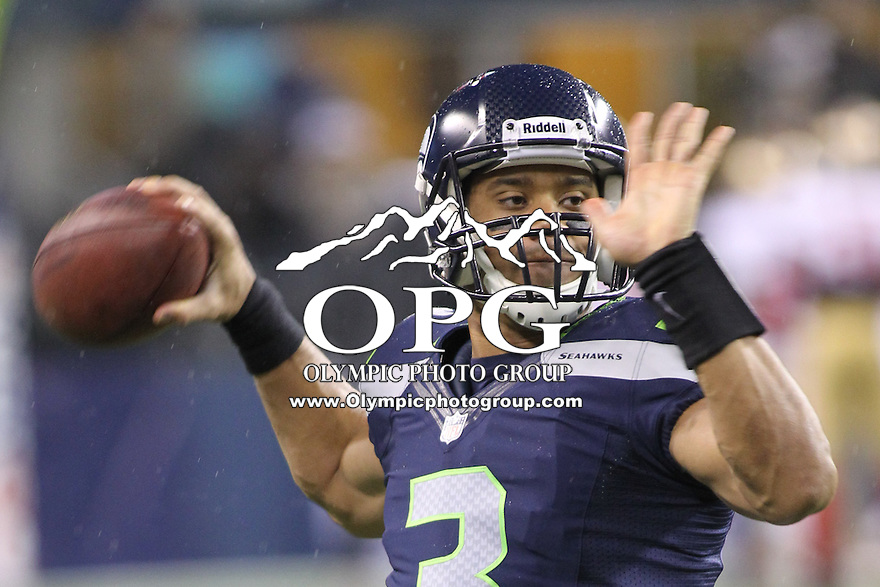 Dec 23, 2012:  Seattle Seahawk's quarterback Russell Wilson against the San Francisco during Sunday nights game of the week at Century Link Stadium in Seattle WA.  Seattle defeated San Francisco 42-13.