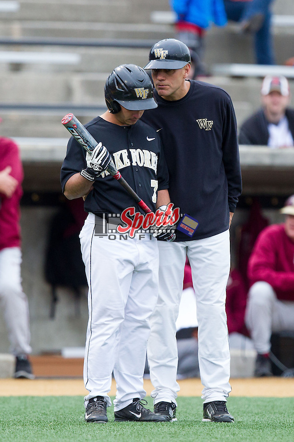 Wake Forest Demon Deacons head coach Tom Walter (16) gives instructions to Joey Rodriguez (7) during the game against the Florida State Seminoles at Wake Forest Baseball Park on April 19, 2014 in Winston-Salem, North Carolina.  The Seminoles defeated the Demon Deacons 4-3 in 13 innings.  (Brian Westerholt/Sports On Film)
