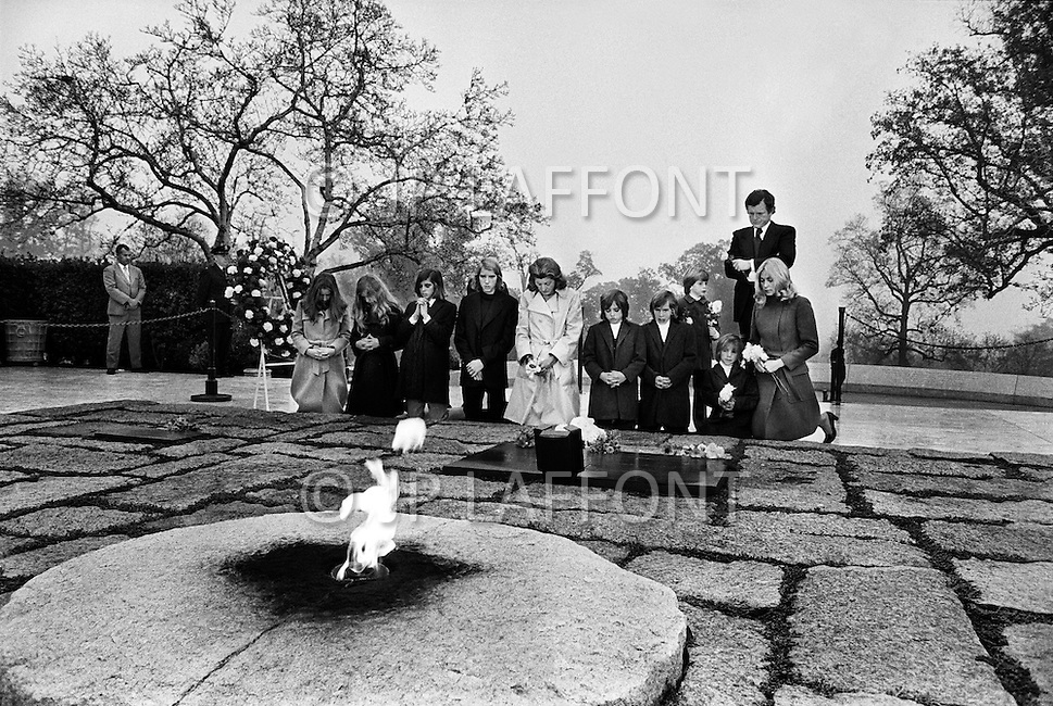 Arlington, VA - November 22, 1973 <br /> Edward Kennedy with wife Joan and sister Patricia Kennedy Lawford and seven of Robert and Ethel Kennedy&rsquo;s children (L-R) Courtney, Kerry, Michael, David, Maxwell, Christopher and Douglas. Standing to the right of Ted is young Patrick. The family visits John F. Kennedy's tomb at Arlington Cemetery to pay tribute to his brother on the anniversary of JFK&rsquo;s assassination.  The tomb and eternal flame were designed by architect John Carl Warnecke, a long-time friend of President Kennedy's and opened to the public on March 15, 1967.
