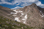 couple, resting, (MR), hike, alpine, tundra, landscape, snowfields, Rowe Peak, adventure, back country, high elevation, recreation, outdoors, adventure, activity, August, morning, Rocky Mountain National Park, Colorado, USA