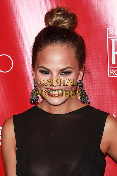 New York, NY- January 31: Chrissy Teigen at Shape &amp; Men's Fitness Kickoff Party at Cipriani 42nd Street on January 31, 2014 in New York City.  <br /> CAP/MPI/COR<br /> &copy;Corredor99/ MediaPunch/Capital Pictures