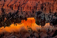 730750092 a small shaft of sunset light brightens a row of hoodoos in the silent city in bryce canyon national park utah
