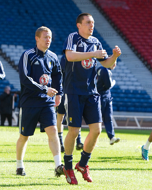 Scott Brown and Barry Robson exhausted after a hard training stint in the Hampden sun
