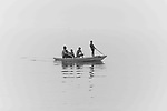 A family ride a boat in the sea. Photo by Sanad Ltefa