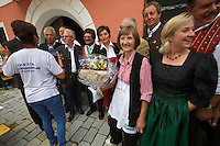 Kärntnernudelfest (Carinthian Dumplings Festival) in Oberdrauburg 2011. Opening group photo with Marlies Mayer, co-organizer of the festival (with white apron).