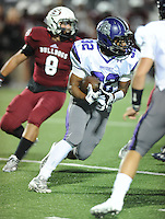 NWA Democrat-Gazette/ANDY SHUPE<br /> Javontae Smith of Fayetteville carries the ball against Springdale Friday, Oct. 9, 2015, during the first half of play at Jarrell Williams Bulldog Stadium in Springdale. Visit nwadg.com/photos to see more photographs from the game.
