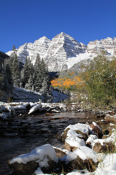Autumn snow and the Maroon Bells Peaks, Aspen, Colorado John offers fall foliage photo tours throughout Colorado.
