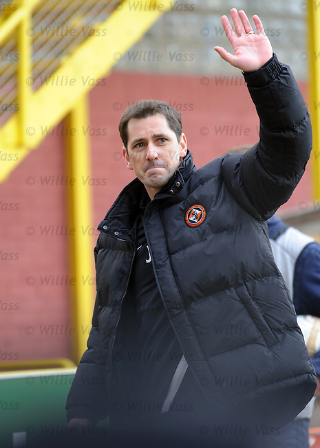 Jackie McNamara salutes the fans at the end of the match