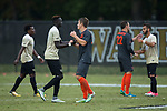 Machop Chol (left) shakes hands with Forrest White (23) of the Virginia Tech Hokies following their ACC Men's Soccer Championship quarterfinal match at Spry Soccer Stadium on November 5, 2017 in Winston-Salem, North Carolina.  The Demon Deacons defeated the Hokies 3-0.  (Brian Westerholt/Sports On Film)
