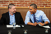 """United States President Obama talks with Mario Orosa, a native Ohioan and has worked in the research and development unit at Goodyear for 12 years, before dinner at the Smith Commons Dining Room and Public House in Washington, D.C., USA, 12 October 2012. Orosa was one of the three winners of the final """"Dinner with Barack"""" fundraising contest. The winners are Kimberley Cathey, Mario Orosa and Joe Laliberte. .Credit: Pete Marovich / Pool via CNP"""