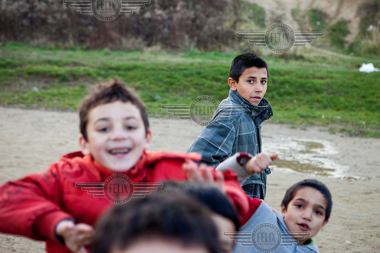 Children playing on a football pitch in Stara Tehelna. This suburb is a segregated district populated by Roma who were moved en mass out of the city centre in 2001