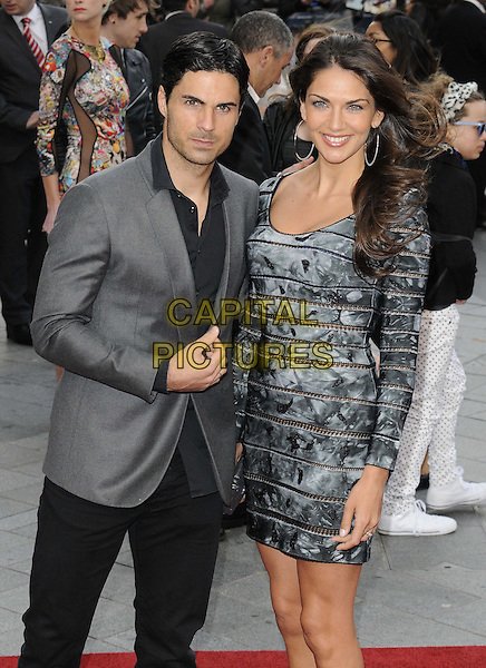 Mikel Arteta & Lorena Bernal.'Iron Man 3' UK film premiere, Odeon cinema, Leicester Square, London, England 18th April 2013..half length dress husband married wife grey gray pattern tie dye suit jacket trousers .CAP/CAN.©Can Nguyen/Capital Pictures.