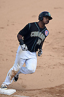 Kane County Cougars outfielder Jeffrey Baez (33) runs the bases after hitting a home run during a game against the Quad Cities River Bandits on August 20, 2014 at Third Bank Ballpark in Geneva, Illinois.  Kane County defeated Burlington 7-3.  (Mike Janes/Four Seam Images)