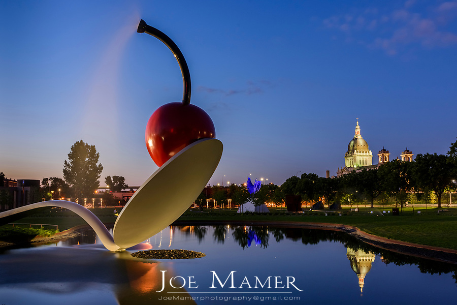 Spoonbridge and Cherry sculpture with the  Basilica of Saint Mary.