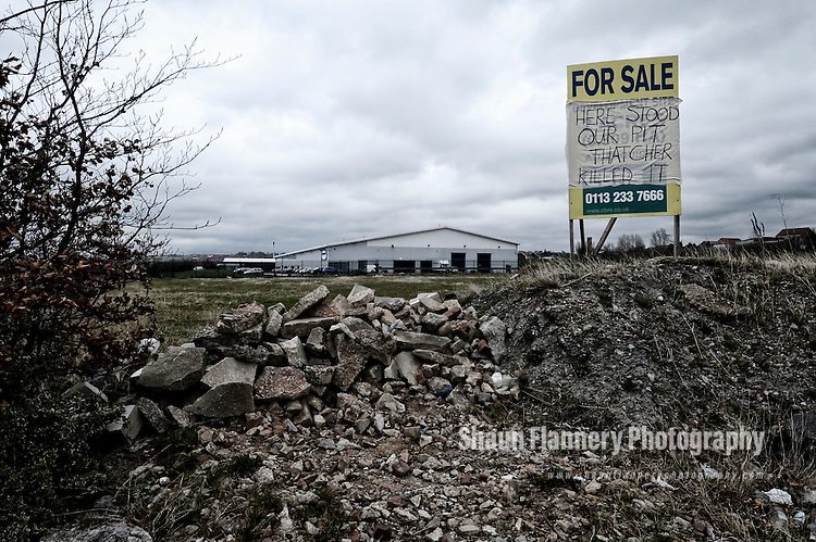 Pix: Shaun Flannery/shaunflanneryphotography.com...COPYRIGHT PICTURE>>SHAUN FLANNERY>01302-570814>>07778315553>>..17th April 2013..Protest sign on a commercial estate agents for sale board at the site of the former Grimethorpe Colliery near Barnsley, South Yorkshire which reads.'Here Stood Our Pit Thatcher Killed It'