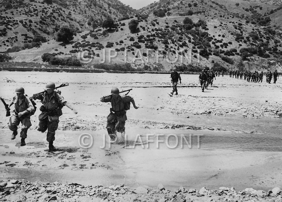 "Ecole Militaire d'Infanterie de Cherchell, Algérie, Sept 1960. EOR (Eleves Officiers de Reserves) The futur infantery officers during their long training walks. They must use to the climate and to the ""djebels"" the hard dry lands of most Algéria. The futur infantery officers during their long training walks of 40 to 50kms with 40lb equipment and hard hat plus arms and amunitions."