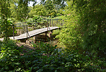 Royal Horticultural Society gardens at Hyde Hall, Essex, England, UK - bridge at Lower Pond