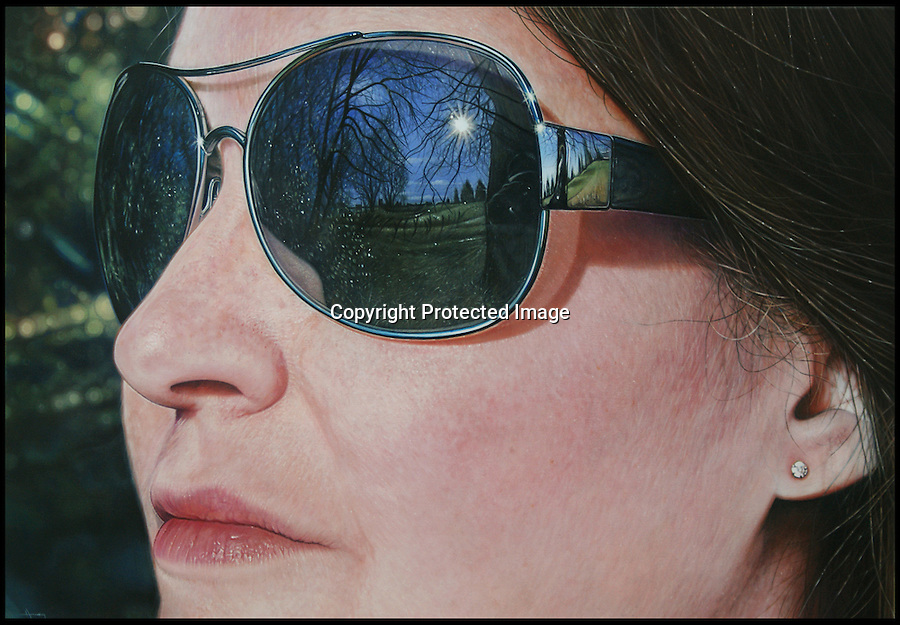 BNPS.co.uk (01202 558833)<br /> Pic: Simon Hennessy/BNPS.<br /> <br /> These recognisable reflections in an array of sunglasses appear to come from a selection of holiday snaps - but they are actually hyper realistic paintings.<br /> <br /> Clever artist Simon Hennessey is able to recreate digital images so well that people often mistake his flawless work for a photograph.<br /> <br /> He has painted dozens of iconic buildings and landmarks as though they are reflected in a pair of tourist's sunglasses, including the Eiffel tower, Big Ben, and Tower bridge.<br /> <br /> Simon's pictures also feature the Guggeneheim museum in New York and the New York City skyline, Skegness seaside, Westminster, and Hyde park.<br /> <br /> To create the lifelike compositions, he takes pictures of the locations and a model wearing sunglasses, before taking to a canvas with an airbrush and acrylic paint.<br /> <br /> His masterpieces can range in size from 11 by 8 inches to an incredible 5ft by 6.5 ft and can take from two weeks to seven months to complete.<br /> <br /> They range in price from 3,000 pounds to 22,000 pounds.