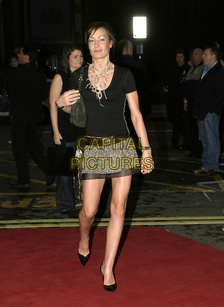 TARA PALMER TOMKINSON.MOBO Awards 2004 - Arrivals, Royal Albert Hall.September 30th, 2004.full length, black shirt, browm mettalic mini skirt, necklace, brown satin trim.www.capitalpictures.com.sales@capitalpictures.com.© Capital Pictures.