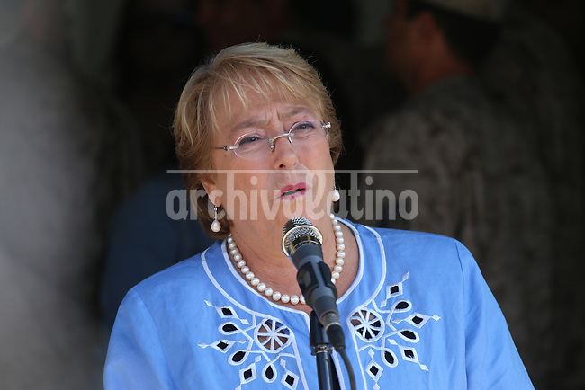 Chilean presidential candidate for th New Majority coalition Michelle Bachelet casts her vote during the run-off presidential election in Santiago on December 15th, 2013