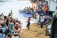 BELLS BEACH, Victoria/AUS (Saturday, March 30, 2013) Tyler Wright (AUS) watches as the crowd gets swamped by the incoming tide. - The Rip Curl Women's Pro Bells Beach presented by Ford, Stop No. 3 of 7 on the 2013 ASP Women's World Championship Tour, completed a mammoth day of competition today with Rounds 2, 3, 4, the Quarterfinals and the Semifinals all ran in pumping four-to-six foot (1.5 - 2 metre) waves at Bells Beach..Tyler Wright (AUS), 18, current ASP WCT No. 1, put on an inspired performance throughout today's five rounds of competition, blending her energetic approach with unmatched power in the Bells Bowl. The young natural-footer closed her day out with a Semifinal win over a rampaging Courtney Conlogue (USA), 20, in classic Bells conditions..This afternoon's Semifinal win earned Wright her third, consecutive Finals berth of 2013 - a Final that can be run as early as tomorrow..Conlogue, despite the near miss in the Semifinals, had a sensational day of competition, posting scores in the excellent range before coming up just short of Wright this afternoon..Carissa Moore (HAW), 20, 2011 ASP Women's World Champion, closed out the day's action with one of the highest-scoring bouts in women's surfing history against California powerhouse Lakey Peterson (USA), 18, in this afternoon's Semifinals..Moore will now face Wright in a rematch from the previous event's Final in Western Australia...Peterson, into her sophomore year amongst the women's elite, was electric throughout today's competition, consistently posting excellent scores en route to her Semifinal clash with Moore..This morning saw reigning five-time ASP Women's World Champion Stephanie Gilmore (AUS), 25, confirm the sustaining of a small undisplaced fracture of the bone in her left foot from her Round 1 heat two days ago. After consulting with physicians and receiving treatment for the injury from on-site medical staff, the phenomenal natural-footer proceeded to surf through three rounds of competition