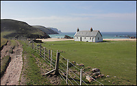 BNPS.co.uk (01202 558833)<br /> Pic: GeoffAllan/BNPS<br /> <br /> This bothy in Kearvaig in the Northern Highlands is nestled in its own secluded bay.<br /> <br /> Views with rooms. - New book reveals the remote 'bothies' that lie hidden in some of Britain's most spectacular locations.<br /> <br /> Nestled away in the beautiful remote wilderness of Scotland are a network of secluded mountain huts - known as bothies - where walkers can stay the night before heading to pastures new.<br /> <br /> What is so special about these quaint outposts in some of the most idyllic and untouched landscapes north of the border is that they are completely free to use.<br /> <br /> As a result, the location of many bothies has been a closely guarded secret with visitor centres reluctant to advertise their whereabouts for fear they become overcrowded.<br /> <br /> But in his new book, The Scottish Bothy Bible, author and photographer Geoff Allan has listed more than 80 of them in a bid to make them known to a wider audience.