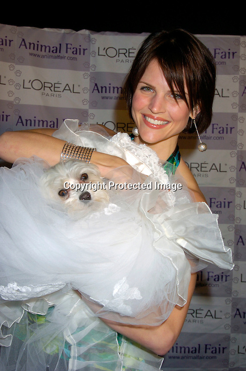 "McKenzie Satterthwaite with  Lucky Diamond ..at Animal Fair's fifth Annual "" Paws for Style"" fashion show to celebrate the 100th year anniversary of the Humane society of New York. The event was on May 24, 2004 at ..Club Black...Photo by Robin Platzer, Twin Images"