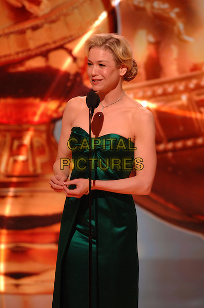 """RENEE ZELLWEGER.Telecast - 64th Annual Golden Globe Awards, Beverly Hills HIlton, Beverly Hills, California, USA..January 15th 2007. .globes half length stage microphone green strapless dress.CAP/AW.Please use accompanying story.Supplied by Capital Pictures.© HFPA"""" and """"64th Golden Globe Awards"""""""