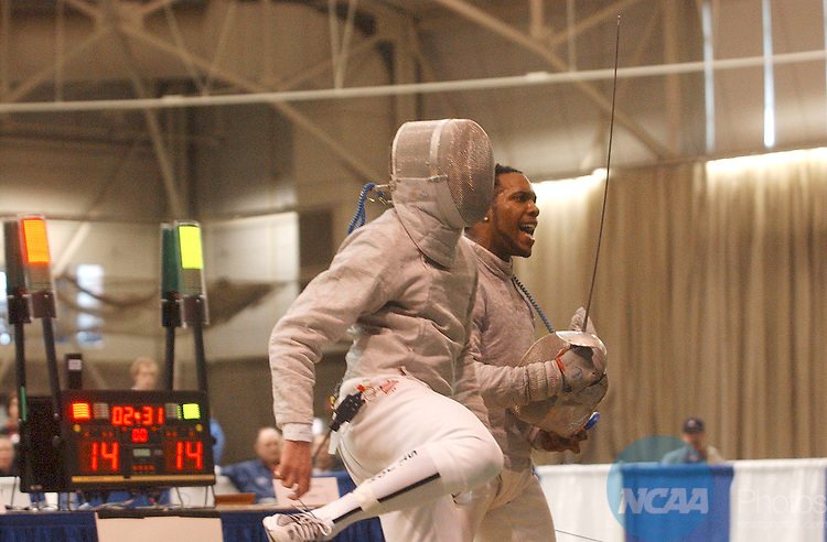 28 MAR 2004: Adam Compton (right) of Ohio State University reacts to scoring a touch on Sergey Isayenko (left) of St. John's University during the Men's Saber event at the 2004 NCAA Division 1 Fencing Championships held at Gosman Athletic Center on the campus of Brandies University in Waltham, MA. Compton placed first in the competition to win the national title. Jim Mahoney/NCAA Photos