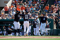 Detroit Tigers third baseman Brandon Dixon (12) is congratulated by Miguel Cabrera (24) and John Hicks (55) as he crosses home plate after hitting a home run in the bottom of the third inning during a Grapefruit League Spring Training game against the Atlanta Braves on March 2, 2019 at Publix Field at Joker Marchant Stadium in Lakeland, Florida.  Tigers defeated the Braves 7-4.  (Mike Janes/Four Seam Images)