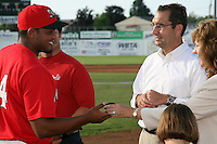 June 19, 2009:  Naomi Silver presents Jairo Martinez with his championship ring as Cardinals General Manager John Mozeliak looks on during a ceremony to award the 2008 NY-Penn League Champions before a game at Dwyer Stadium in Batavia, NY.  The Batavia Muckdogs are the NY-Penn League Short Season Class-A affiliate of the St. Louis Cardinals.  Photo by:  Mike Janes/Four Seam Images