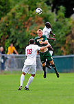 13 September 2009: University of Vermont Catamount midfielder Kyle Luetkehans, a Junior from LaGrange, IL, jumps to head the ball against the University of Massachusetts Minutemen during the second round of the 2009 Morgan Stanley Smith Barney Soccer Classic held at Centennial Field in Burlington, Vermont. The Catamounts and Minutemen battled to a 1-1 double-overtime tie. Mandatory Photo Credit: Ed Wolfstein Photo