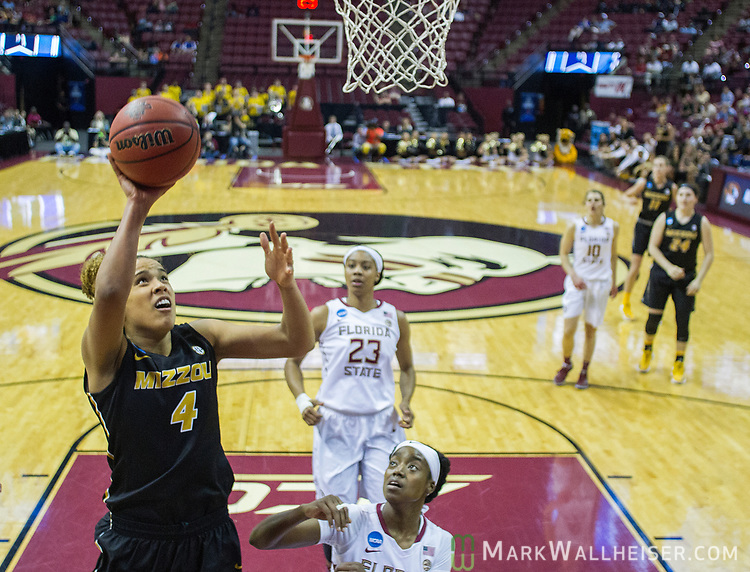 Missouri forward Cierra Porter goes up for a shot during the first half of a second-round game of the NCAA women's college basketball tournament against Florida State in Tallahassee, Fla., Sunday, March 19, 2017. (AP Photo/Mark Wallheiser)