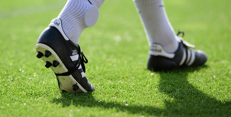 A close up fo the boots of Lincoln City's head of sports science and medicine Mike Hine<br /> <br /> Photographer Chris Vaughan/CameraSport<br /> <br /> The EFL Sky Bet League Two - Carlisle United v Lincoln City - Friday 19th April 2019 - Brunton Park - Carlisle<br /> <br /> World Copyright © 2019 CameraSport. All rights reserved. 43 Linden Ave. Countesthorpe. Leicester. England. LE8 5PG - Tel: +44 (0) 116 277 4147 - admin@camerasport.com - www.camerasport.com