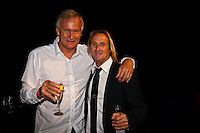 GOLD COAST, Queensland/Australia (Friday, February 24, 2012) Simon Anderson (AUS) with Iain Ratso Buchanan (NZL).  The 29th Annual ASP World Surfing Awards went off tonight at the Gold Coast Convention and Exhibition Centre with the worlds best surfers trading the beachwear for formal attire as the 2011 ASP World Champions were officially crowned.. .Kelly Slater (USA), 40, and Carissa Moore (HAW), 19, took top honours for the evening, collecting the ASP World Title and ASP Womens World Title respectively.. .I have actually been on tour longer than some of my fellow competitors have been alive, Slater said. All joking aside, its truly humbling to be up here and honoured in front of such an incredible collection of surfers. I want to thank everyone in the room for pushing me to where I am...In addition to honouring the 2011 ASP World Champions, the ASP World Surfing Awards included new accolades voted on by the fans and the surfers themselves...For the first time in several years, ASP Life Membership was awarded to Hawaiian legend and icon of high-performance surfing, Larry Bertlemann (HAW), 56...Where surfing is today is where I dreamed it should be in the 70s, Bertlemann said. You guys absolutely deserve this and Im so honored to be up here in front of you all tonight..Grammy Award-winning artists Wolfmother and The Vernons rounded out the nights entertainment which was all streamed LIVE around the world on YouTube.com..Photo: joliphotos.com