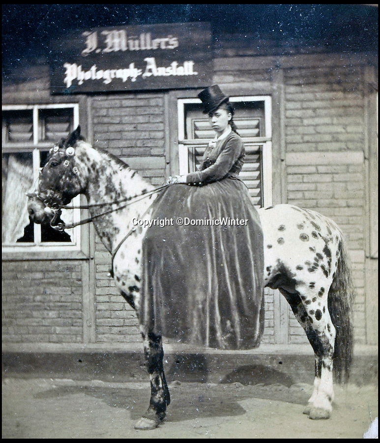 BNPS.co.uk (01202 558833)Pic: DominicWinter/BNPS<br /> <br /> Mademoiselle Ida Stoodley the 'graceful and highly accomplished equestrienne' <br /> <br /> These remarkable photos capture life in a 19th century touring circus which twice performed for the Queen.<br /> <br /> The collection of over 150 images tells the story of the circus of 'Lord' George Sanger who performed for Queen Victoria at Sandringham in 1885 and at Balmoral Castle in 1898. <br /> <br /> One remarkable photo shows the whole troupe of 30 performers in front of the circus ring with the acrobats forming a three people high human pyramid in the background.<br /> <br /> Tragically, in 1911 Sanger was murdered with a hatchet at his home at Park Farm, Finchley, by employee Herbert Charles Cooper, who then committed suicide.