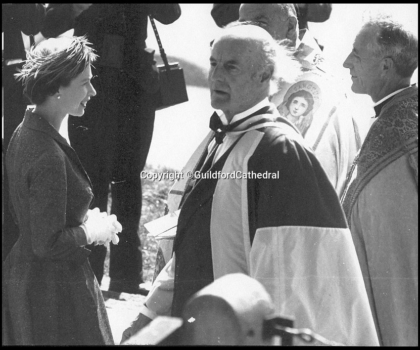 BNPS.co.uk (01202 558833)<br /> Pic: GuildfordCathedral/BNPS<br /> <br /> Queen at the opening in 1961.<br /> <br /> Bad omens..<br /> <br /> One of Britains great cathedral's could be closed down if an emergency appeal for &pound;1.3 million is not successful by the end of August.<br /> <br /> Historic Guildford cathedral, where cult horror film The Omen was filmed, is facing closure because its ceiling is laced with asbestos.<br /> <br /> The 10,000sq ft ceiling of Guildford Cathedral was sprayed with a special acoustic plaster made from the deadly mineral in a bid to improve the sound quality when it was built in the 1960s.<br /> <br /> Fifty years on the ceiling has started to crumble forcing church bosses to launch an appeal to raise &pound;7 million pounds to pay for its restoration.<br /> <br /> They say that if the money can't be raised they will have no choice but to close its doors for good - the first British cathedral ever to do so.<br /> <br /> To add further pressure to the campaign, they have to raise 1.3 million pounds by the end of August in order to qualify for a Heritage Lottery Fund.<br /> <br /> More than 200,000 people paid two shillings and sixpence - the equivalent of 12.5 pence today - to buy a brick when the price of building materials shot up after World War II.