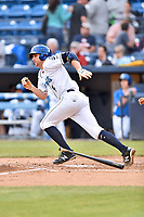Asheville Tourists shortstop Ryan Vilade (4 ) runs to first base during a game against the Greensboro Grasshoppers at McCormick Field on May 11, 2018 in Asheville, North Carolina. The Tourists defeated the Grasshoppers 10-5. (Tony Farlow/Four Seam Images)