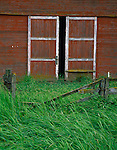 Whitman County, WA<br /> Weathered fence line in front of a set a barn doors on the Kelley Homestead barn near Oakesdale, in the Palouse