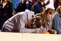 UVa fans Catherine Dworak, left, and Stephanie Colen, right, react during the final moments of the game against Duke at Scott Stadium in Charlottesville, VA. Duke defeated Virginia 35-22. Photo/Andrew Shurtleff