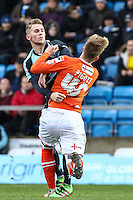 Jason McCarthy of Wycombe Wanderers and Joe Pigott of Luton Town battle for the ball during the Sky Bet League 2 match between Wycombe Wanderers and Luton Town at Adams Park, High Wycombe, England on 6 February 2016. Photo by David Horn.