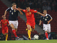 Mirko Ivanovski holding off Christophe Berra in the Scotland v Macedonia FIFA World Cup Qualifying match at Hampden Park, Glasgow on 11.9.12.