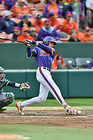 Clemson Tigers shortstop Logan Davidson (8) swings at a pitch during a game against the Notre Dame Fighting Irish at Doug Kingsmore Stadium on March 11, 2017 in Clemson, South Carolina. The Tigers defeated the Fighting Irish 6-5. (Tony Farlow/Four Seam Images)