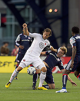 DC United defender Carey Talley (8) attempts to control the ball as New England Revolution forward Zack Schilawski (15) defends. The New England Revolution defeated DC United, 1-0, at Gillette Stadium on August 7, 2010.