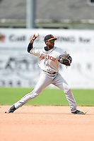 Connecticut Tigers shortstop Domingo Leyba (7) throws to first during the second game of a doubleheader against the Batavia Muckdogs on July 20, 2014 at Dwyer Stadium in Batavia, New York.  Connecticut defeated Batavia 2-0.  (Mike Janes/Four Seam Images)