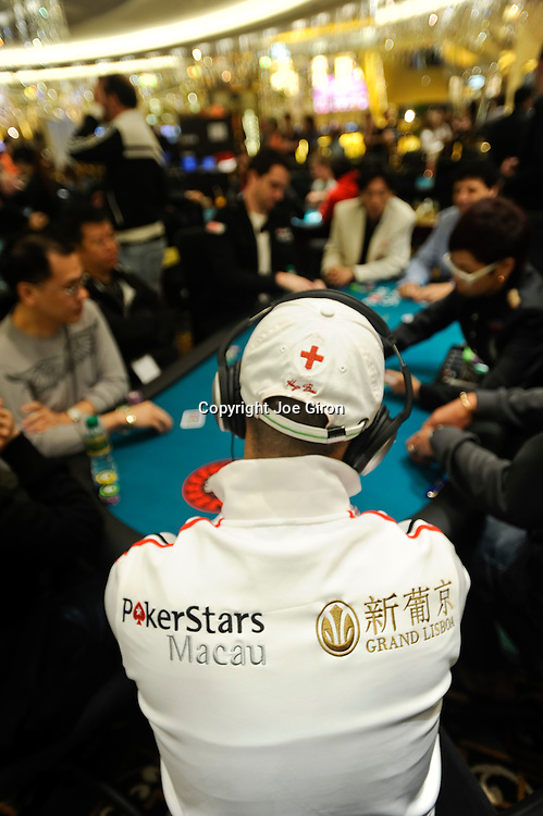 A player's jacket wtih Pokerstars and Grand Lisboa branding.